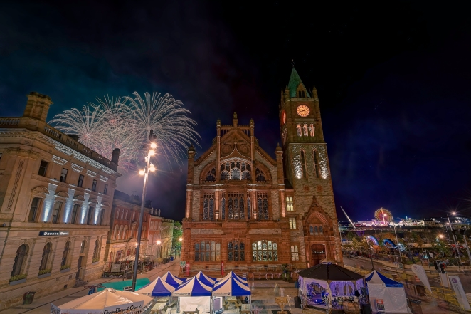 "An HDR shot of the Halloween fireworks over Derry, Northern Ireland. This photo was taken from the famous ""Walls"" of the city, with this section of them overlooking Guildhall Square. The building with the clock tower in the centre of the frame is the Guildhall which presides over Guildhall Square. To the right of the building, you can see one of the angular arms of the Peace Bridge which spans the River Foyle. You can also see the lights coming from the funfair that was situated in Ebrington Square, in the Waterside part of the city. Derry was recently voted by the readers of USA Today as being the top Halloween destination in the world, beating off competition from the likes of Transylvania, Sleepy Hollow and Salem, Masaachusetts. This is an HDR photograph, merged from 3 different shots. It was taken with a Nikon D810 camera, using a Nikkor 16-35mm f/4 wide angle lens. The photos were cleaned up using DXO Pro Optics 10, merged using Photomatix Pro 5 and then edited using Adobe Lightroom 5 and Adobe Photoshop CS6. Thanks for looking! Nikon D810, Nikkor 16-35mm, 17mm, f/10, ISO 100, 4sec,"